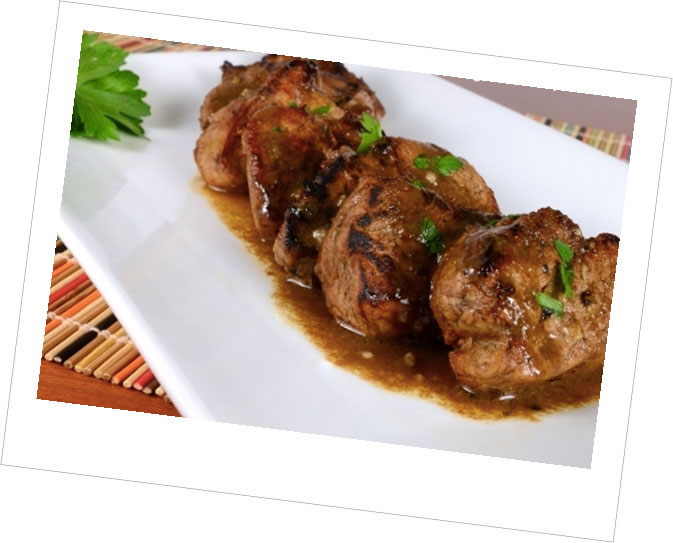 Medallions of Pork in a Mushroom & Bacon Sauce with Buttered Herb Crumbs